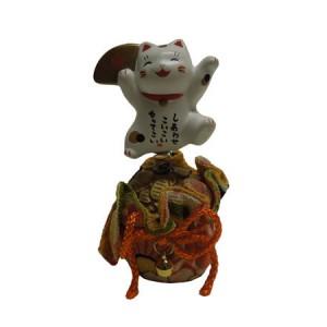 Chat maneki neko, en porcelaine du japon, avec un sac de richesse