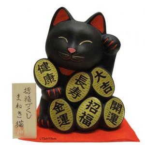 Chat maneki neko du japan, tenant six pieces d'or